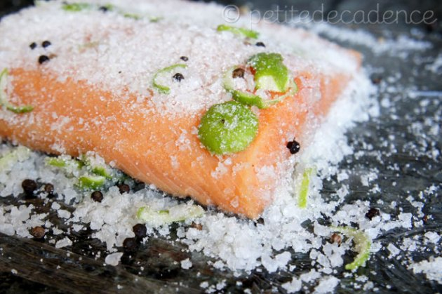 Patting the salt into the salmon
