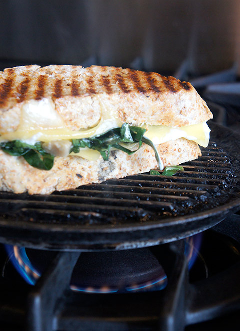 Artichoke and spinach grilled cheese sandwich, on grill